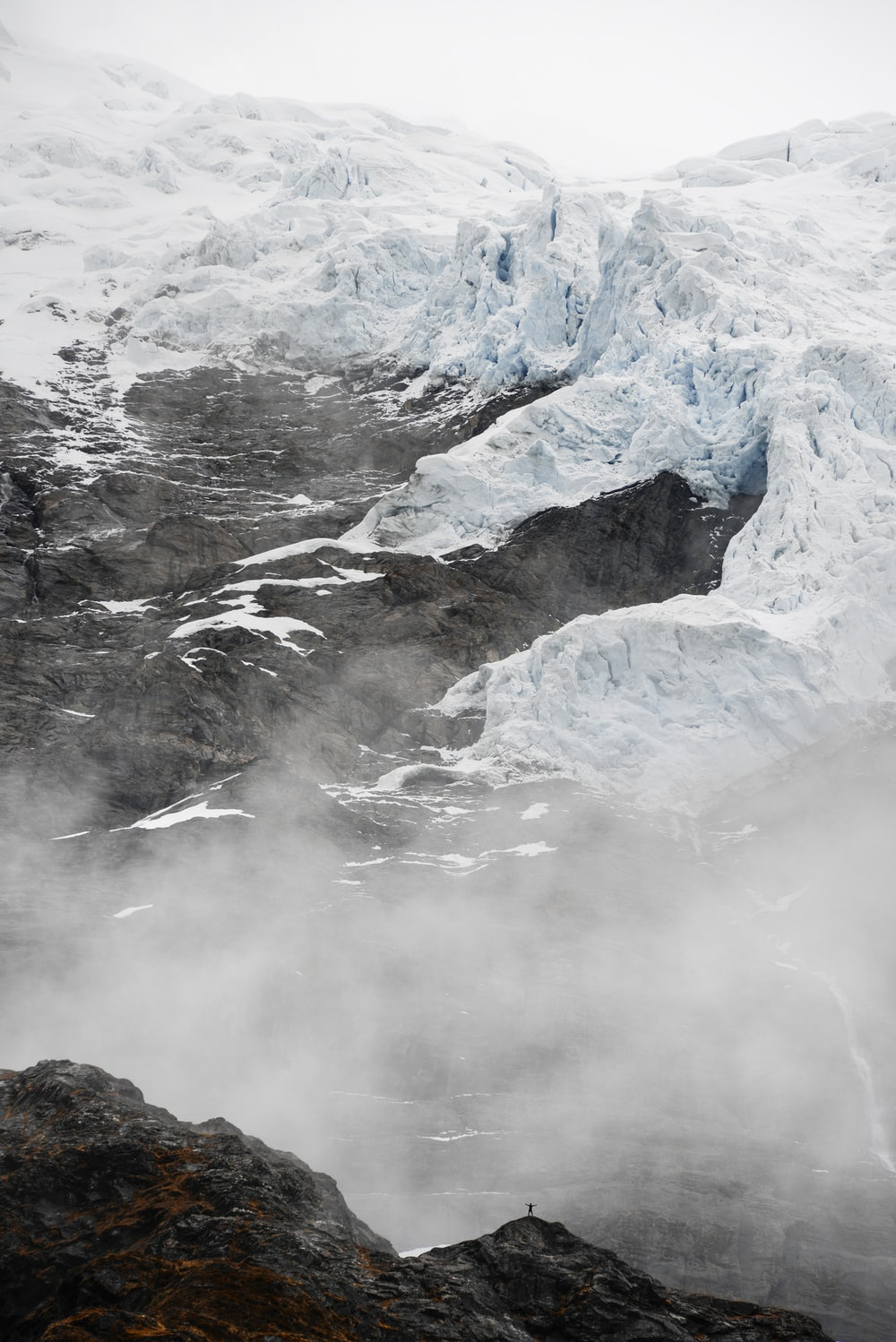 mountains covered with snow and fog