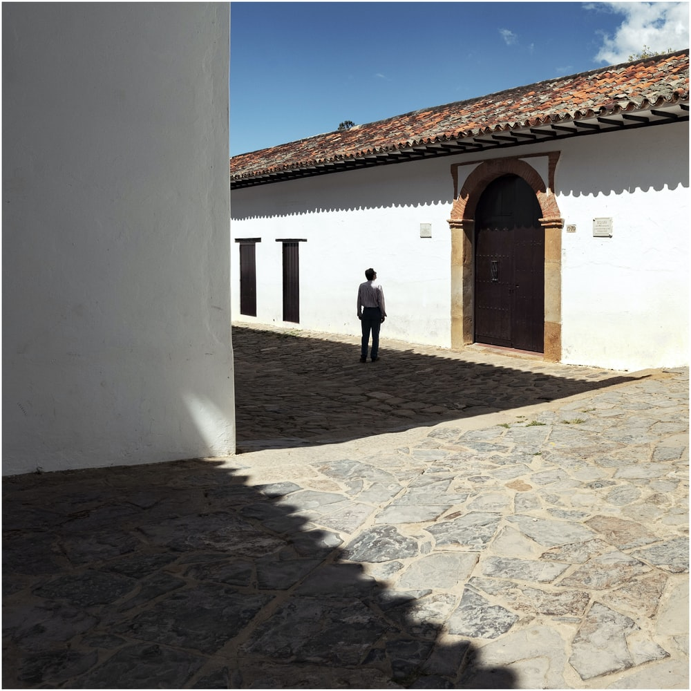 man looking at brown roof