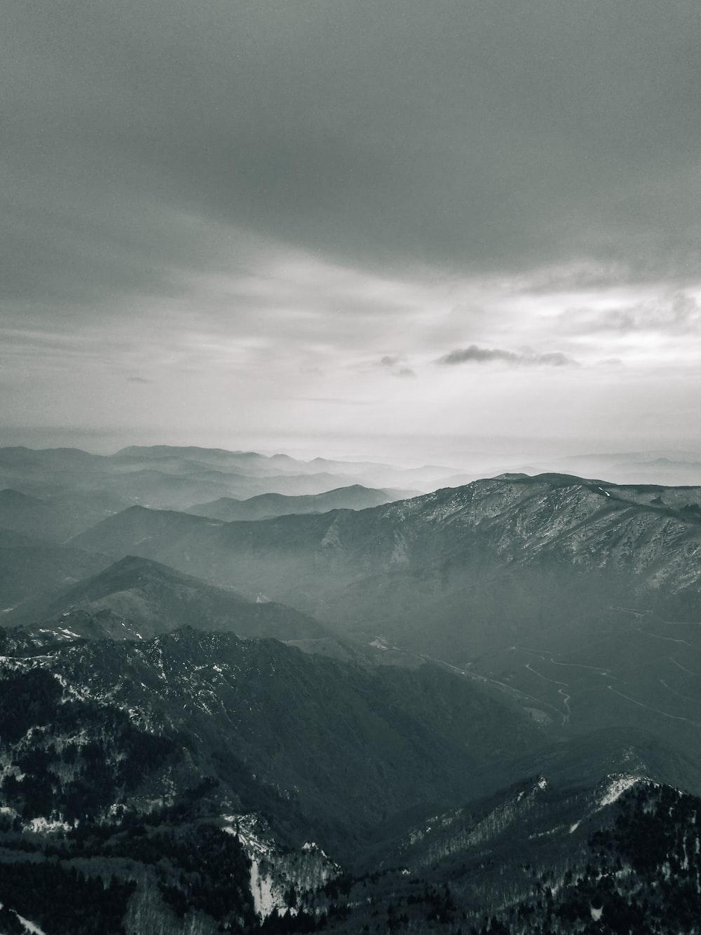 black rocky mountain during daytime