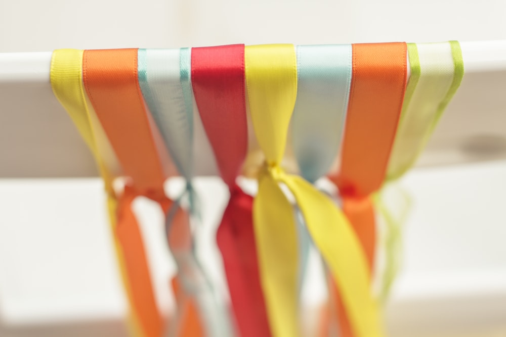 assorted-color ribbons on white bar