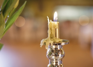 selective focus photography of lighted candle