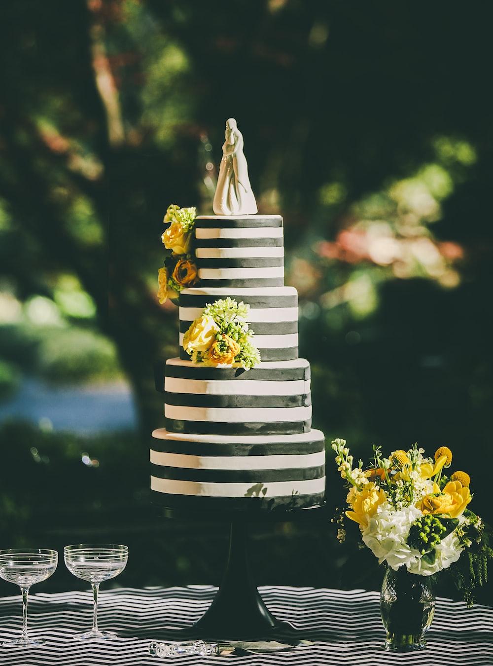 round 4-layered cake on black tray
