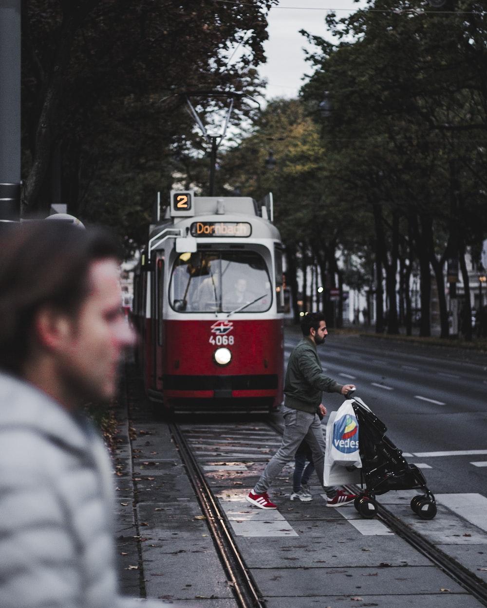 man crossing train railway