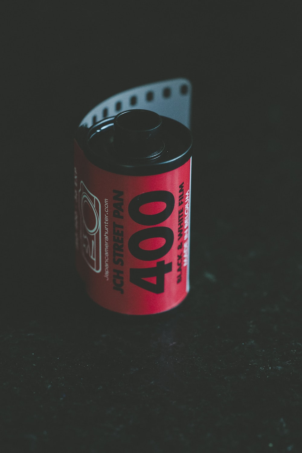 shallow focus photo of red film reel