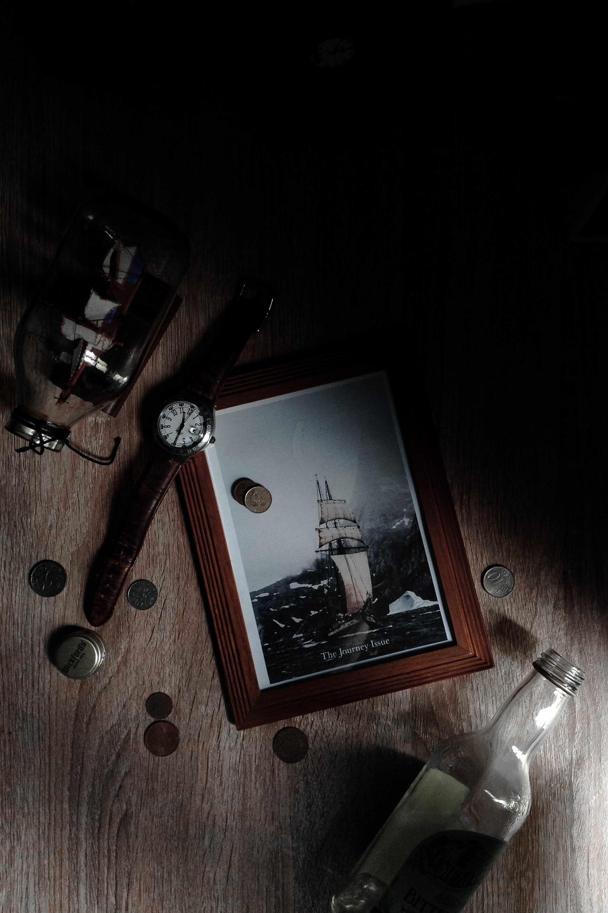white clipper ship painting with brown wooden frame
