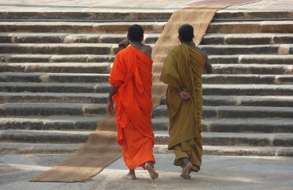 Buddhist monks wearing orange and yellow robes