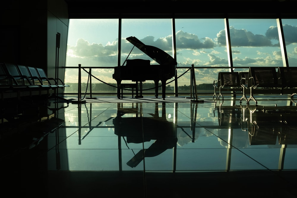 silhouette of grand piano inside building