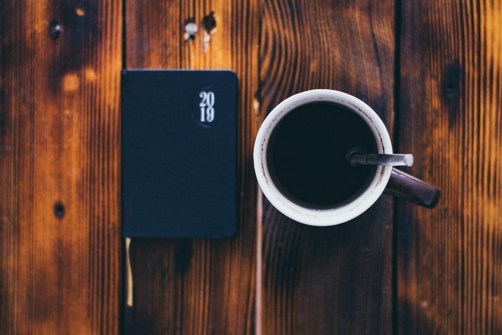 coffee in mug beside 2019 planner