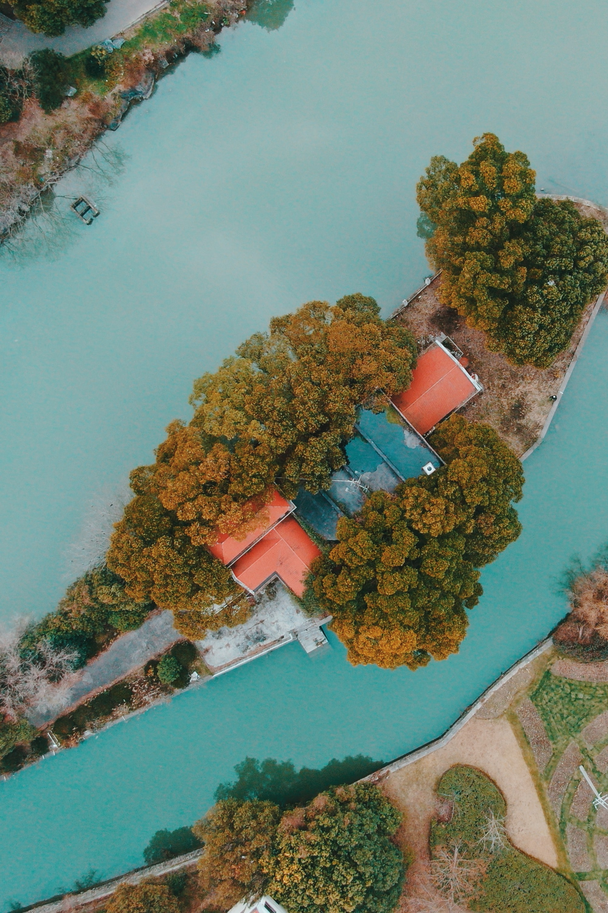aerial photo of house with red roof in an islet