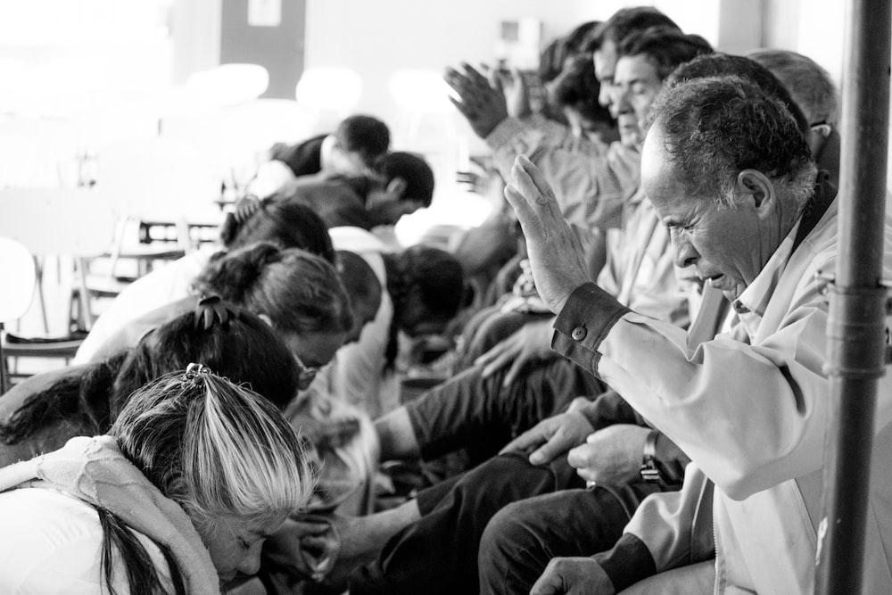 people praying over