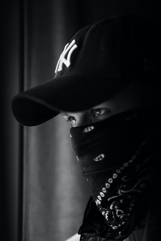 grayscale photo of man with bandana