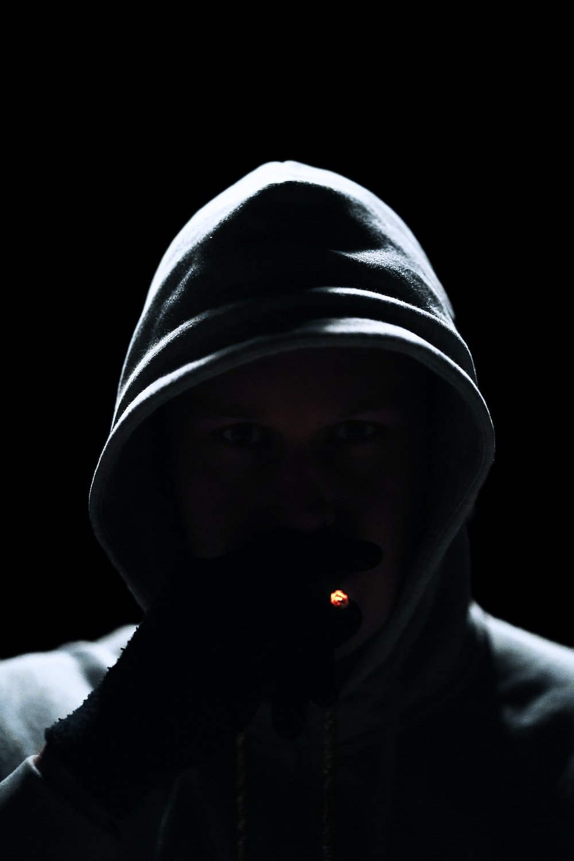 man wearing hooded jacket