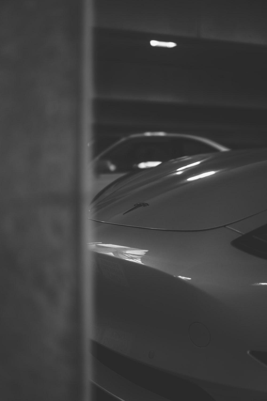 grayscale photo of car hood