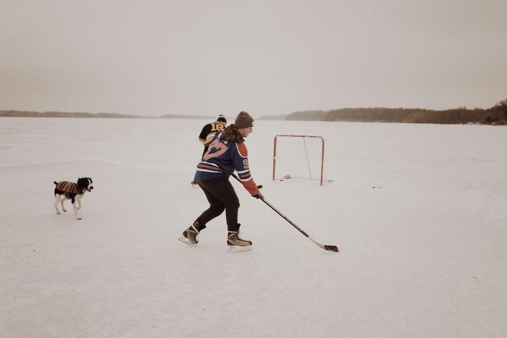 man playing ice hockey