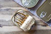 sardines in can on table