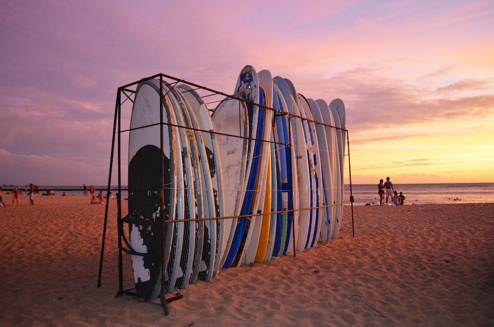 organize surfboard in rack at beach