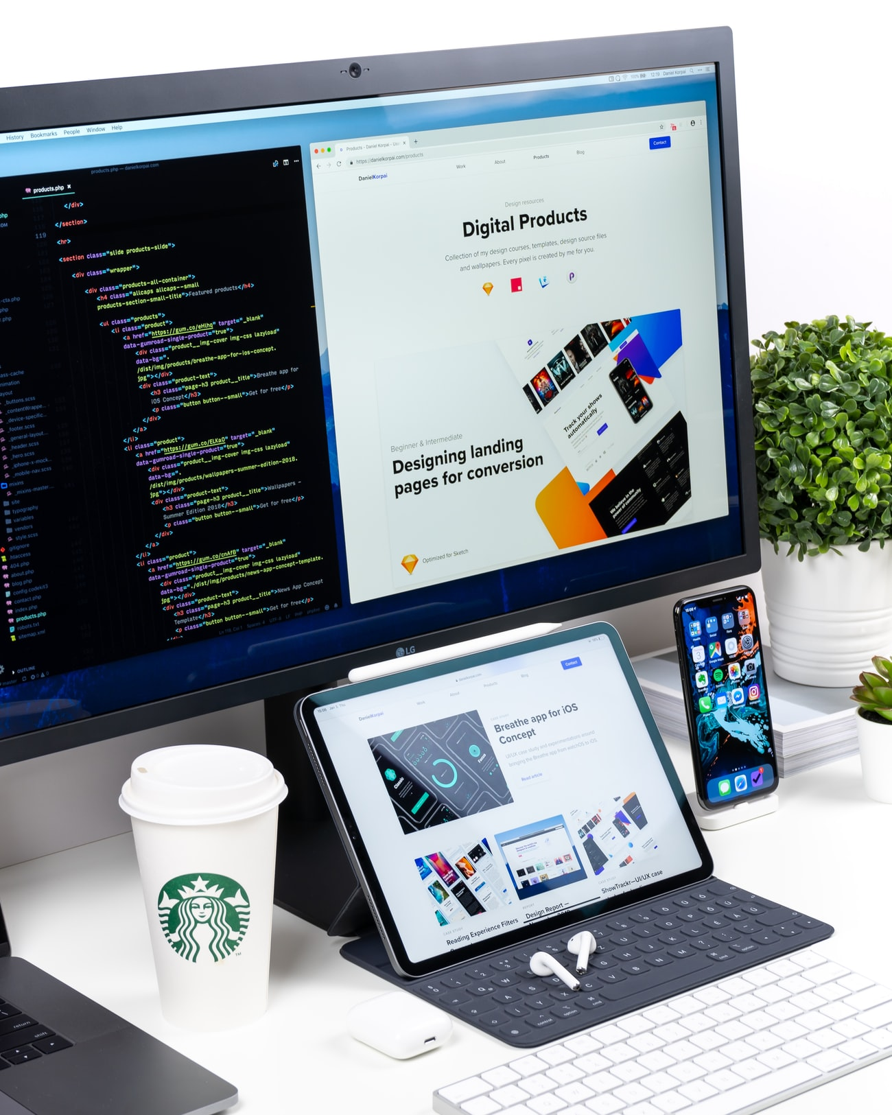 tablet with a Starbucks coffee cup and desktop PC