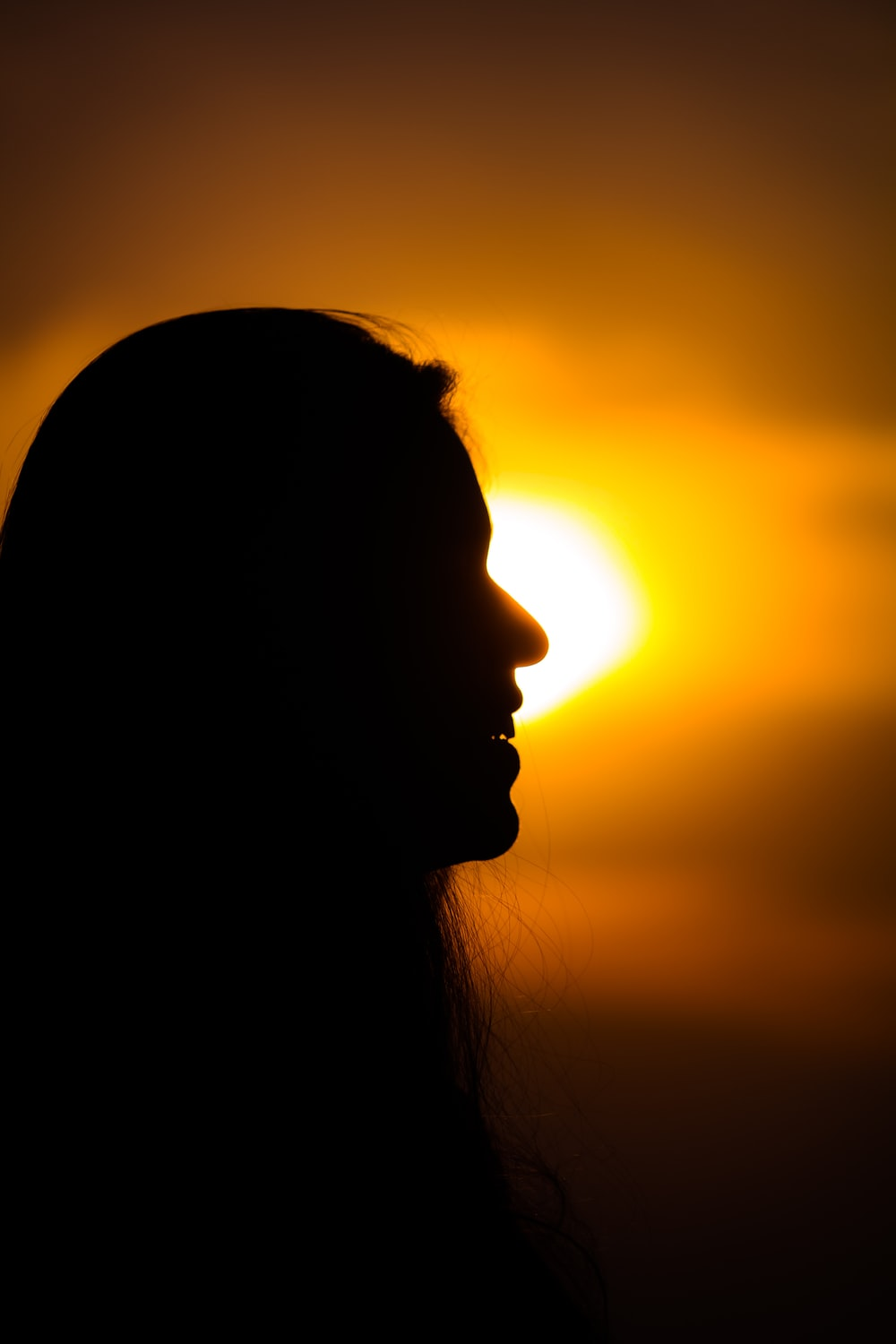 silhouette photography of smiling woman