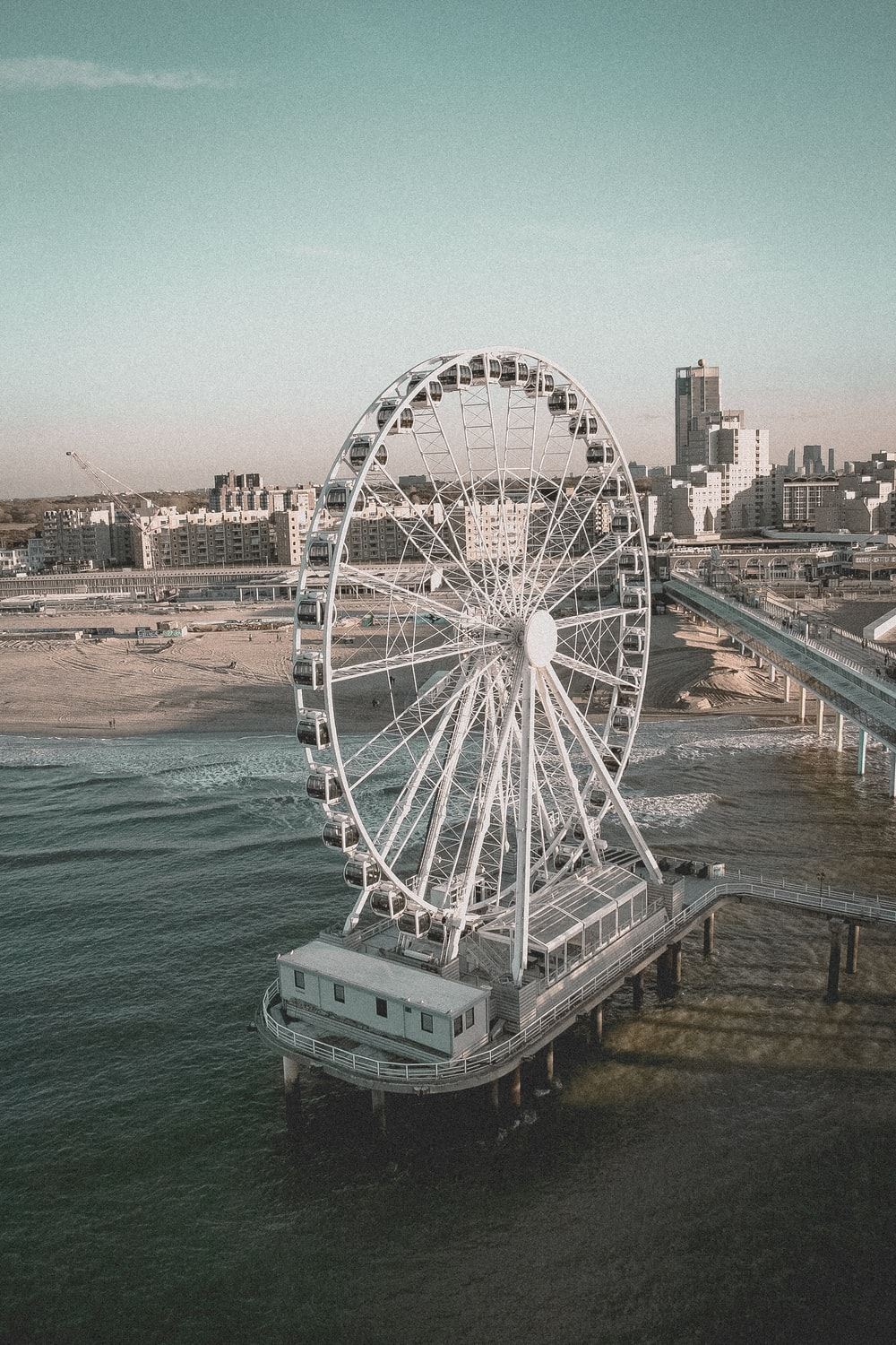 white ferris wheel near body of water