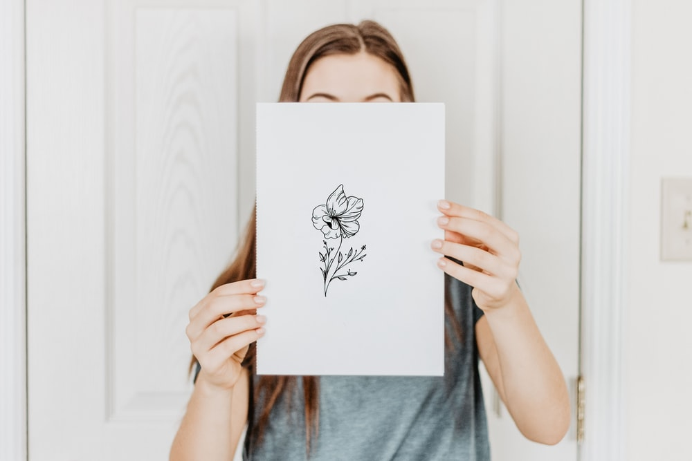 woman holding paper
