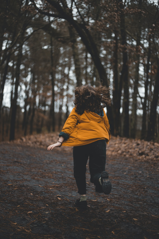 person in orange jacket running