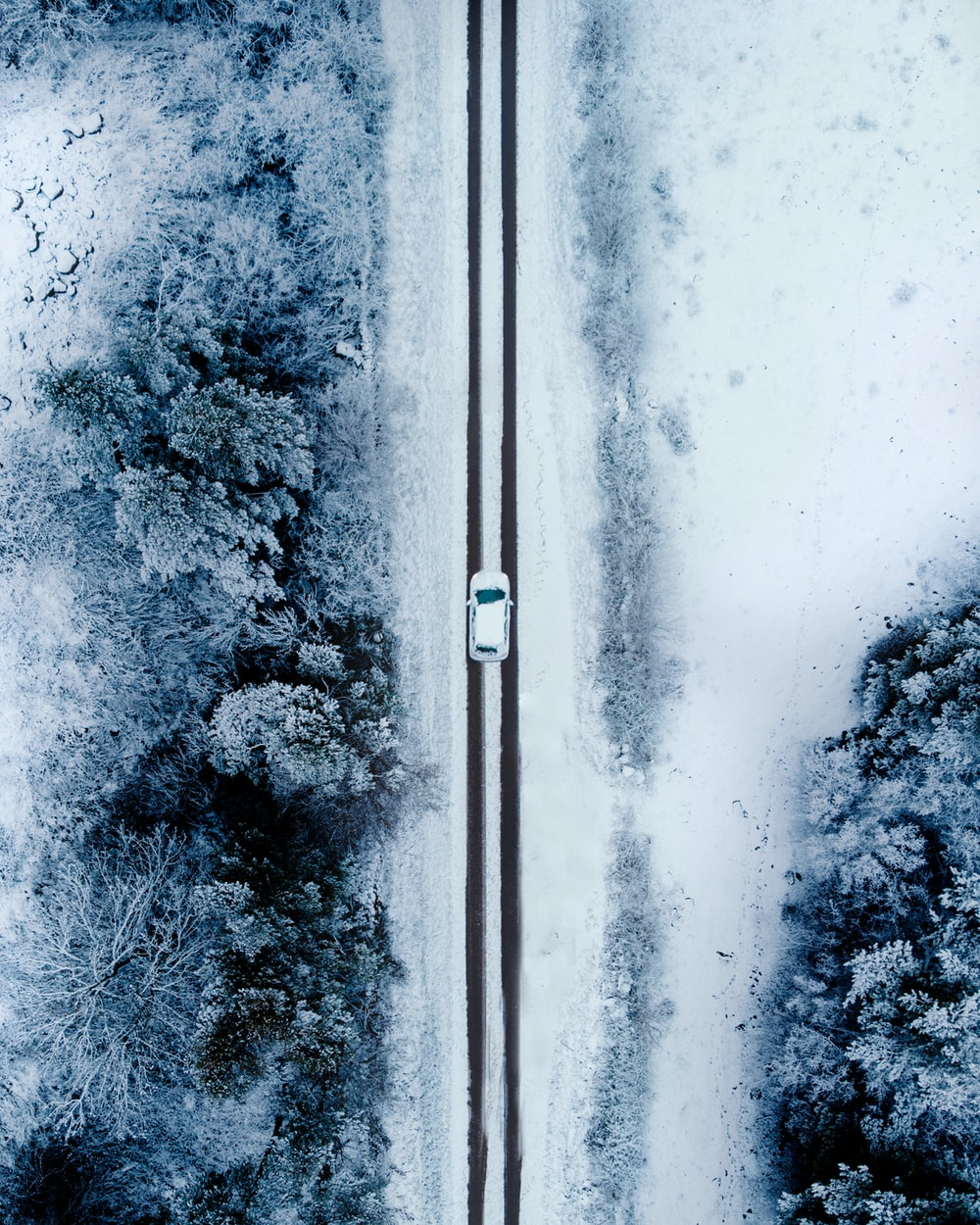 aerial photo of car on snow field
