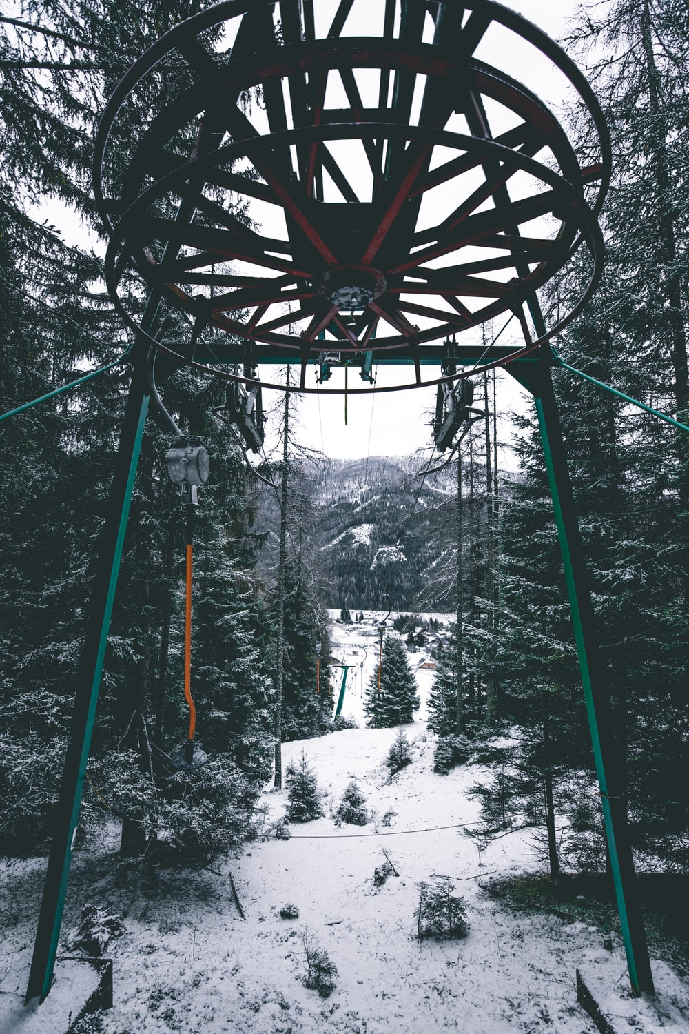 black and gray cable car tower at middle of forest