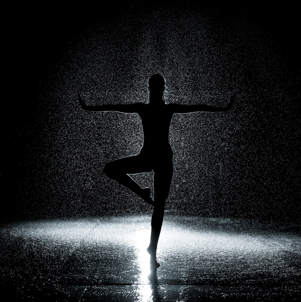 woman in posture under rain