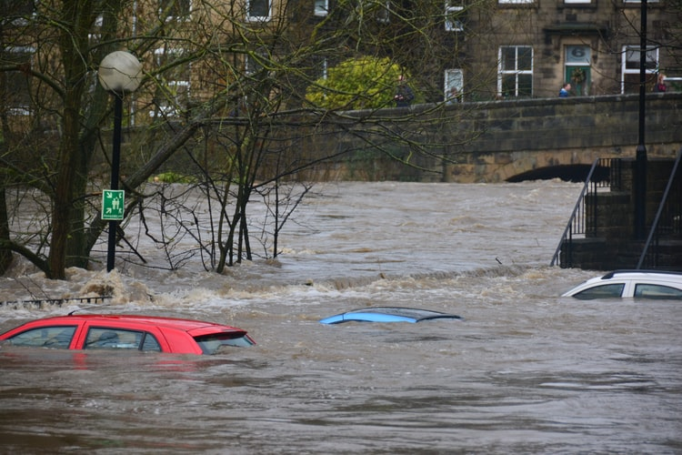 Cars submerged in flooding