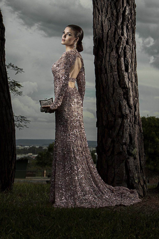 woman in gray glitter gown standing beside tree
