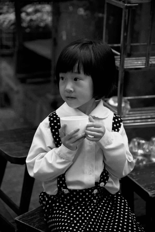 grayscale photography of girl in polka-dot skirt