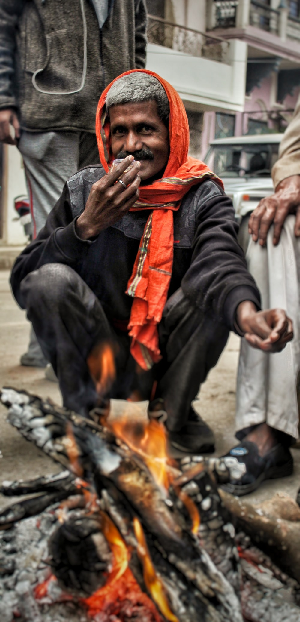 man sitting near bone fire