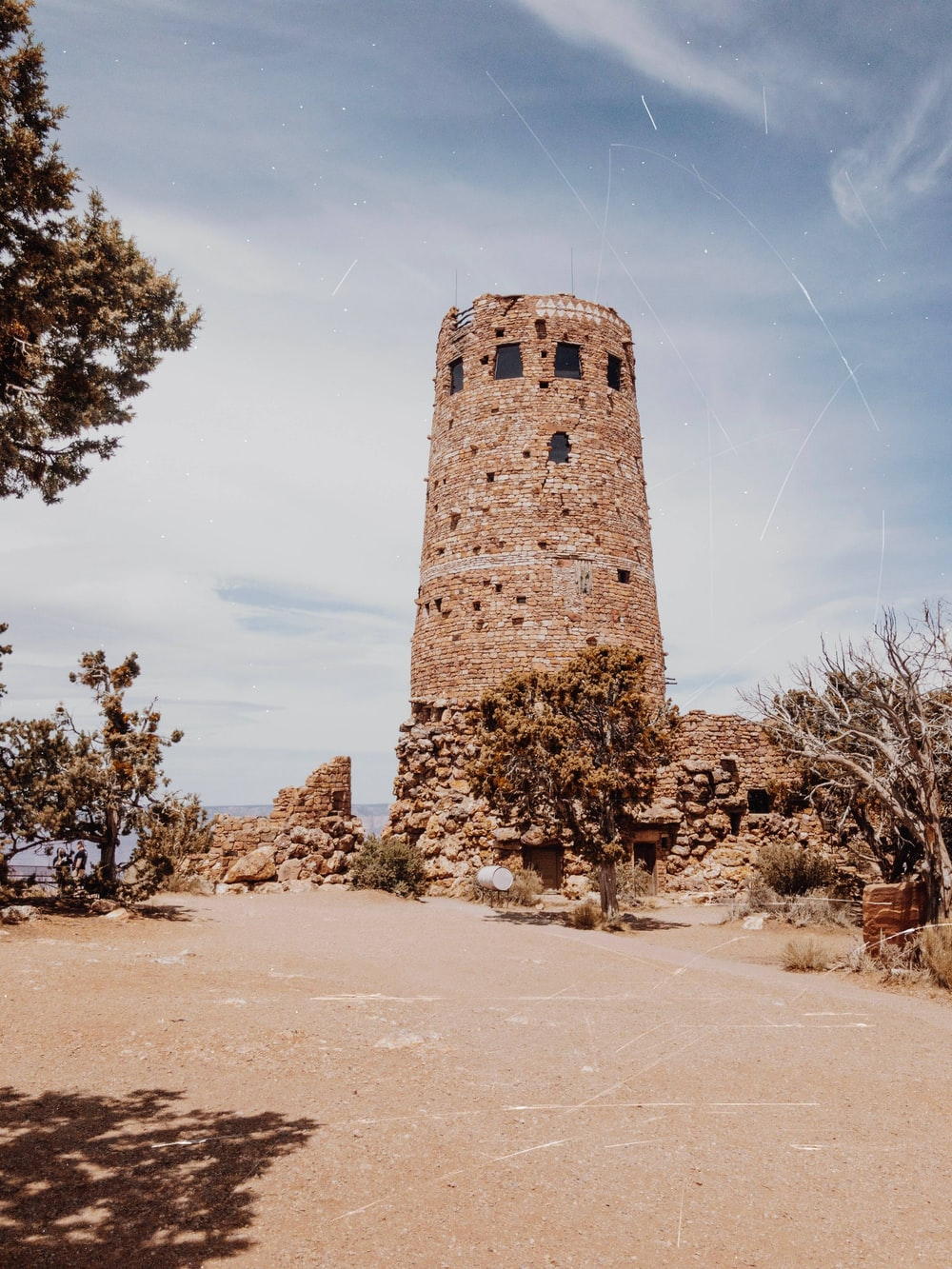 tower by the cliff during daytime