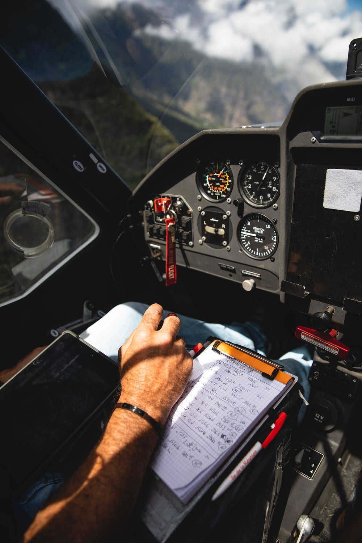 man writing while driving