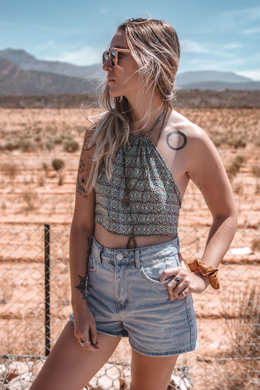 women's gray halter crop top and blue denim shorts