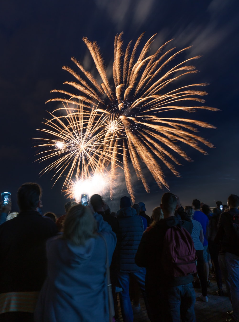 people gathering and watching fireworks display