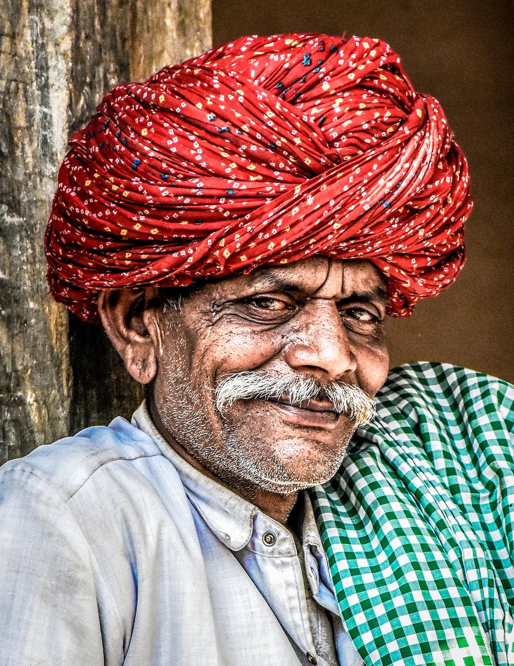 man wearing red turban