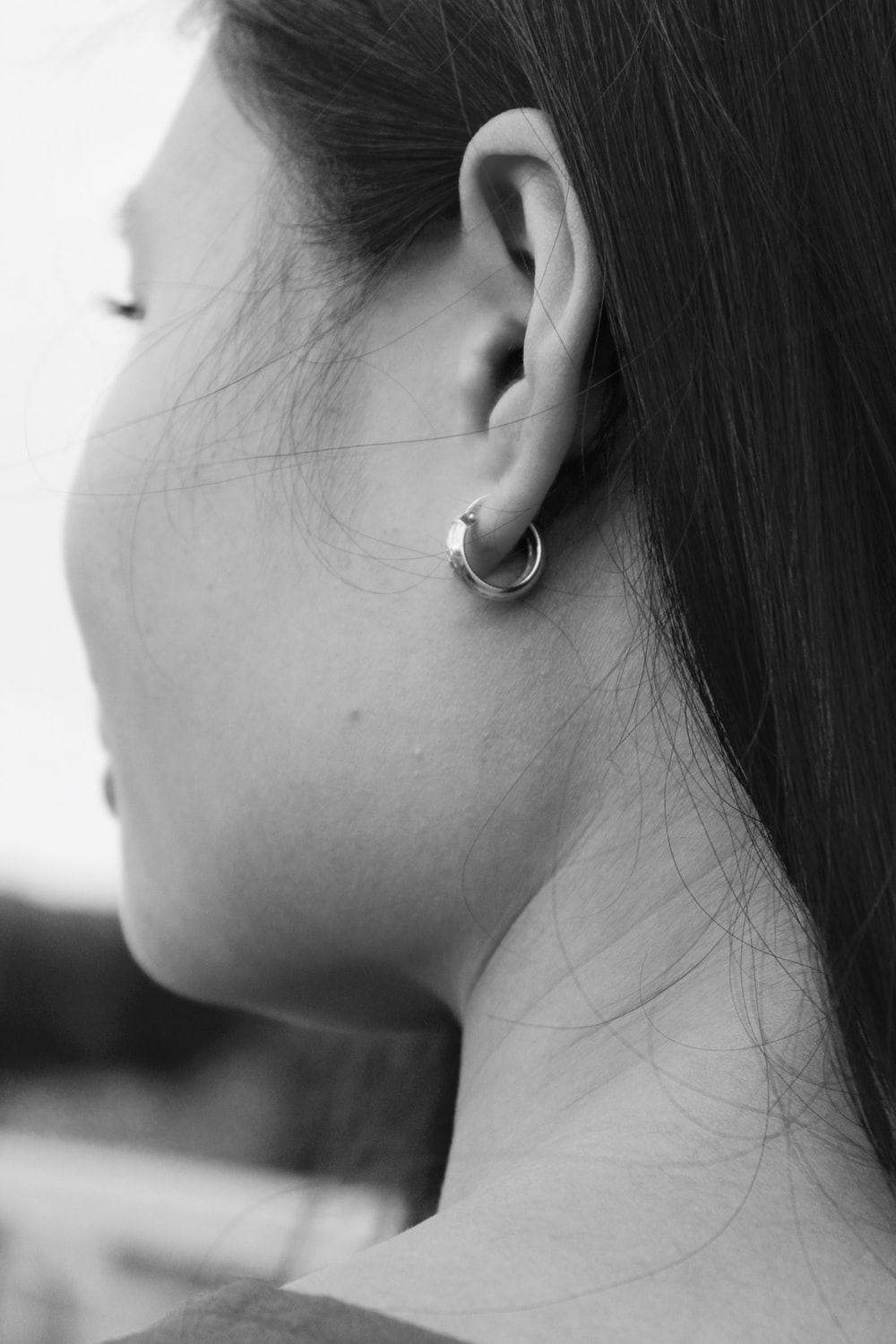 grayscale photography of woman wearing hoop earring