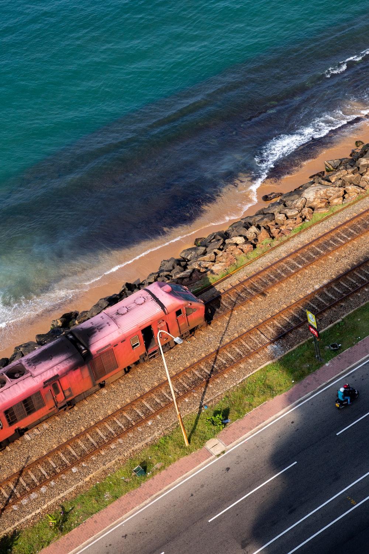 red train on rail train