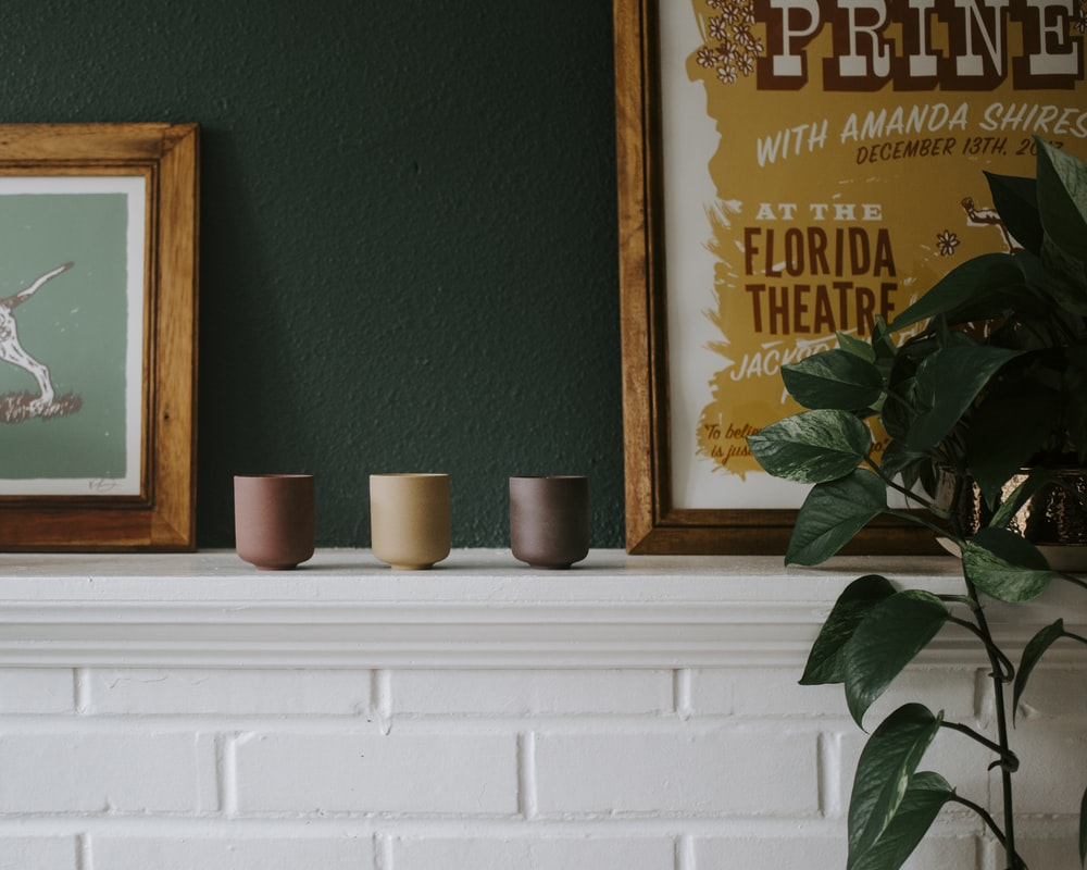 assorted-colored ceramic pots