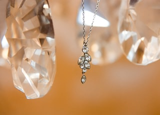 clear gemstone silver-colored pendant necklace