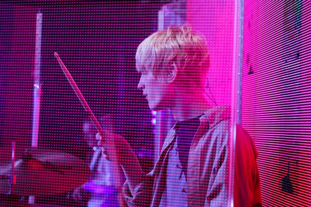 man holding drum stick photo