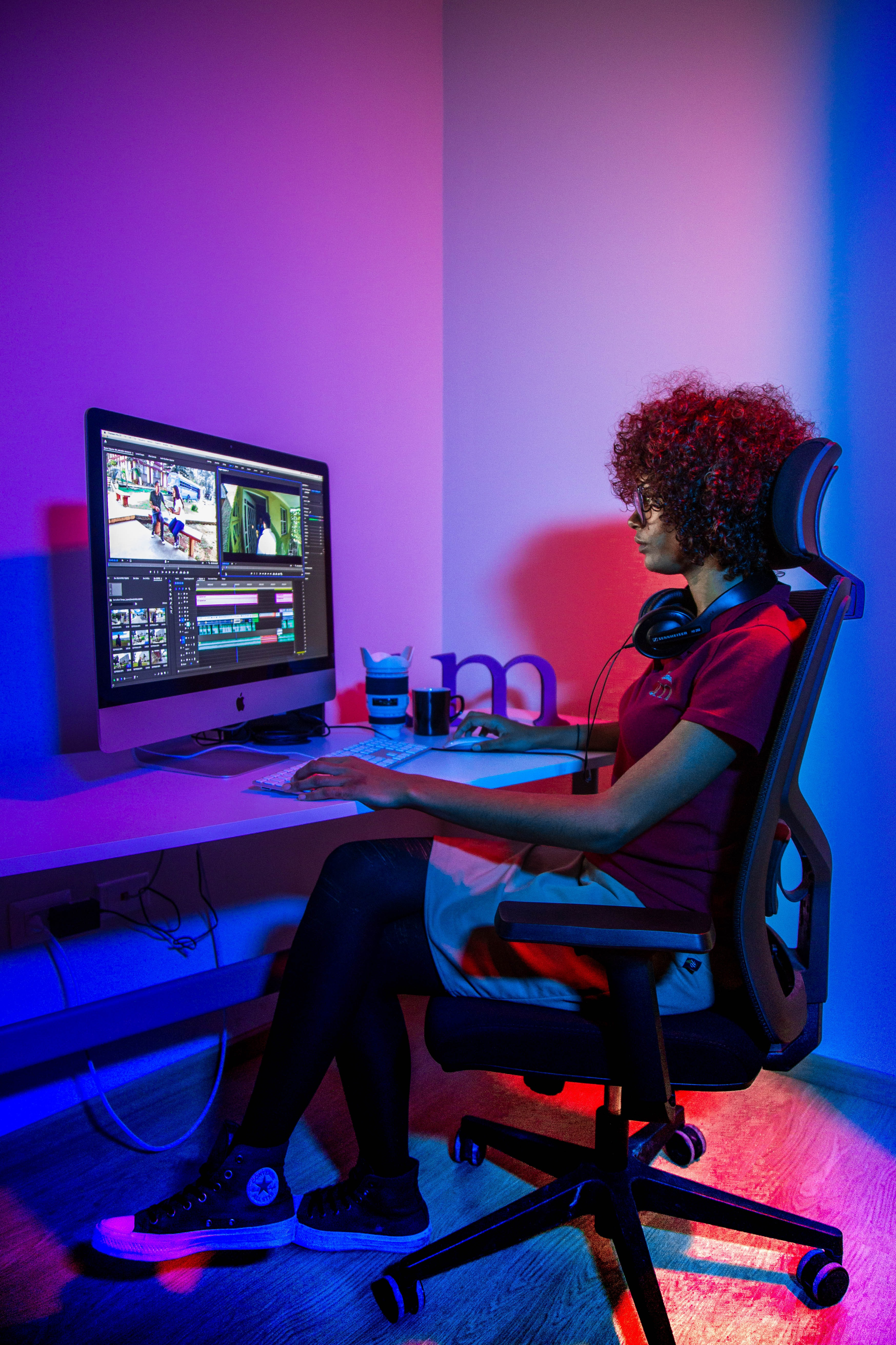 woman sits in front of open computer