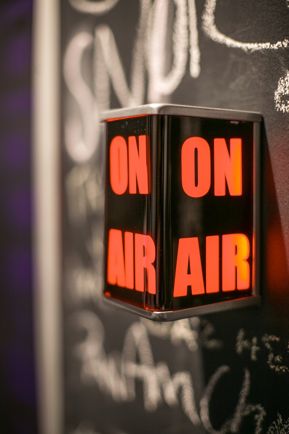 selective focus photography of on air signage
