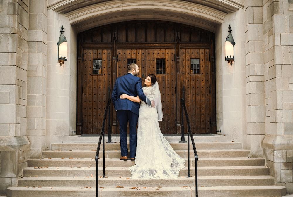 groom and bride in front of door