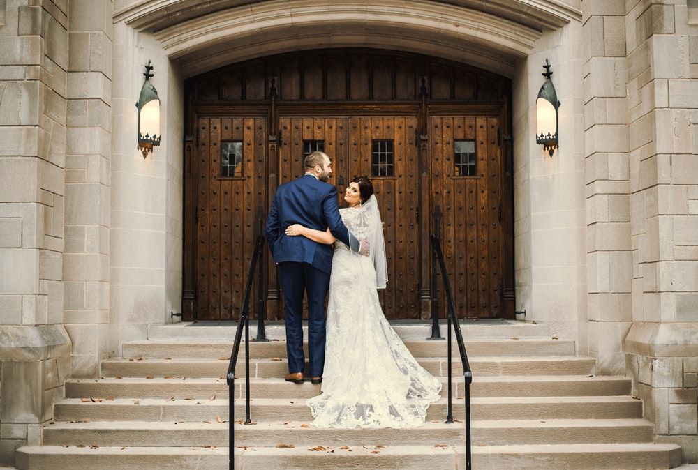 groom and bride in front of door