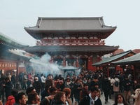 people in front of red temple