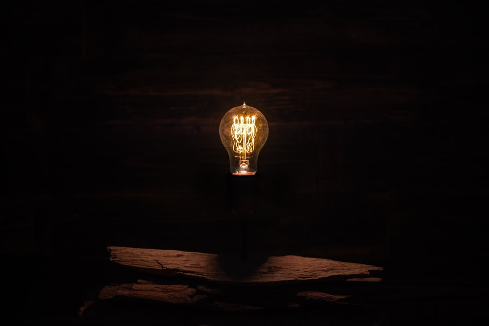 lighted incandescent lamp on wall
