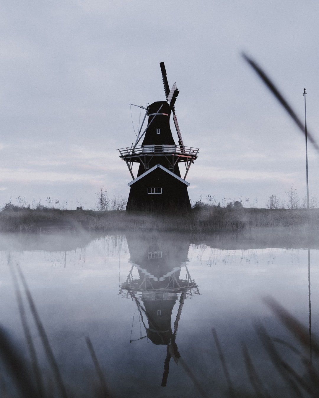 When i woke up early and looked out the window i saw the mist coming of the water. I grabbed my camera and ran to the windmill in my village. I've been wanting to photograph this windmill everyday since I rode by this on my way to school. When I saw the mist i knew it was the part of my photo which i was looking for for so long.