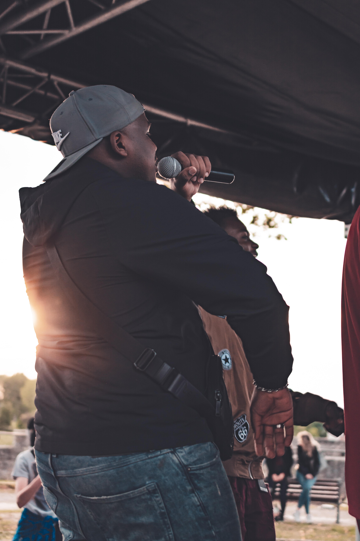 man singing in stage